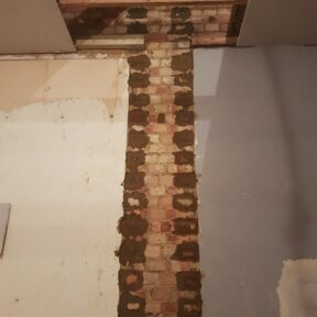 Chimney breast removed. Party wall repaired