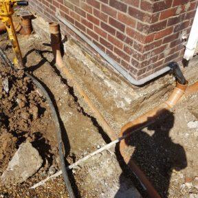 Underground drainage takes kitchen waste and soilstack on right handmade