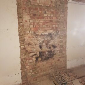 Party wall brickwork repaired