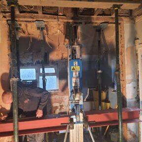 RSJ being installed using a genie lift